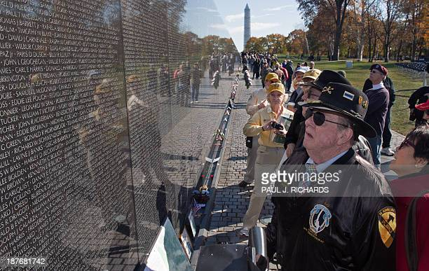 War author and correspondent Joesph Galloway pays his respects at the Vietnam Memorial wall on Veterans Day November 11 2013 in Washington DC...