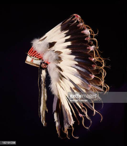 War bonnet of eagle tail feathers each feather signifying a specific war honour It belonged to the Arapaho Chief Yellow Calf USA Plains Indian Arapaho