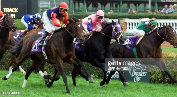 War Chant with jockey Gary Stevens leads second place finisher North East Bound and jockey Jose Velez Jr and third place finisher Dansili with jockey...