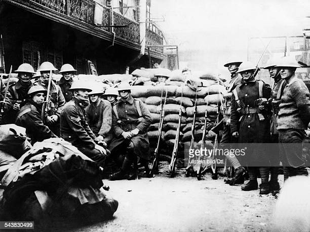 War ChinaJapan 193745 British and US soldiers in Shanghai protecting behind sandbags the International Zone at the Bund in Shanghai