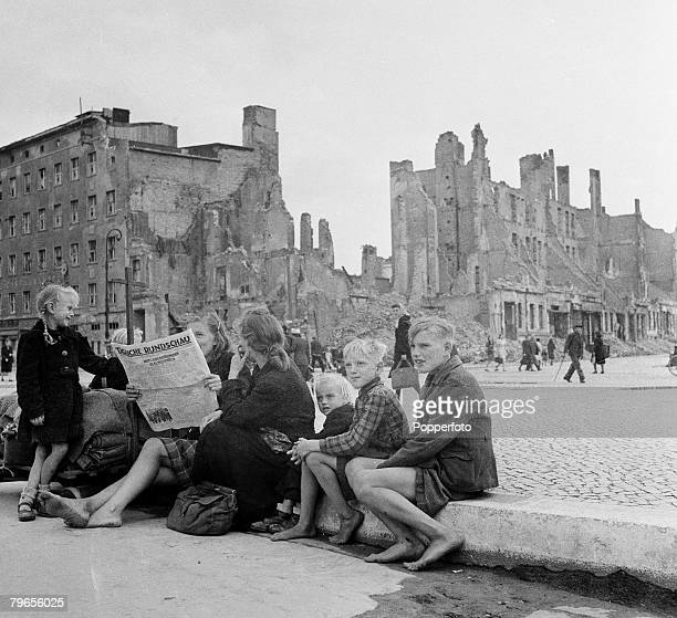 War Conflict Berlin Germany 14th April 1946 A family sit on a wall in a Berlin street after arriving from eastern Germany they are just some of the...