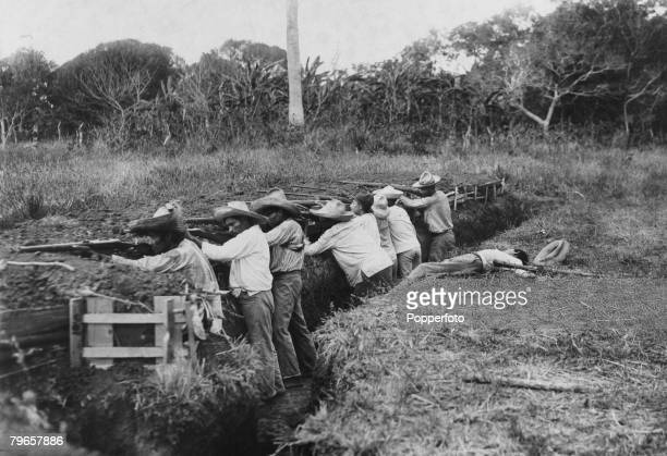 War Conflict Revolution in Mexico Circa 1910's Rebel troops in a trench armed with rifles
