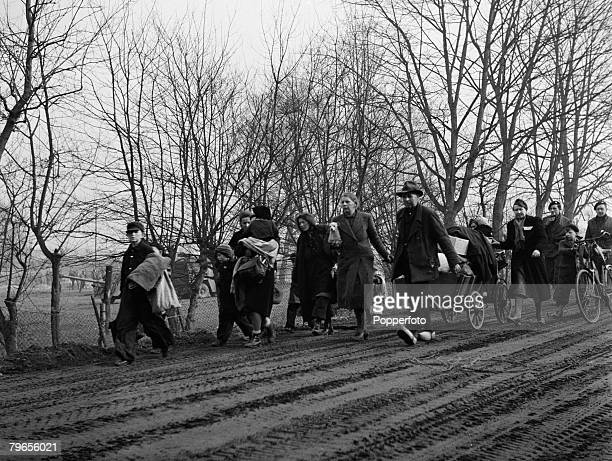 War Conflict World War Two Belgium February 1945 German civilians with their belongings walk to the Allied army lines to escape the fighting near...