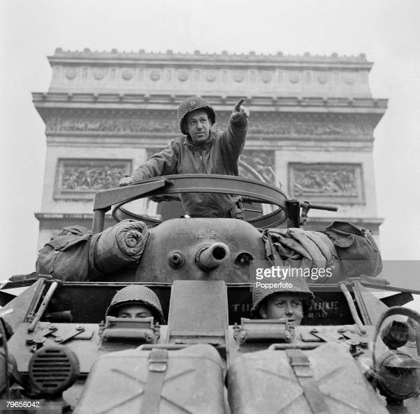 War Conflict World War Two France August 1944 The Liberation of Paris American Army Captain William Ruenzle points from the turret of his armoured...