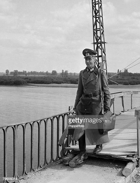 War Conflict World War Two Unknown location A German officer and several hundred soldiers march over the bridge to surrender to Allied forces