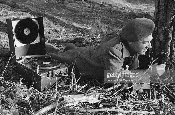 BBC war correspondent Frank Gillard at work in early 1944 during a mock battle to rehearse the reporting of the DDay landings for BBC radio He is...