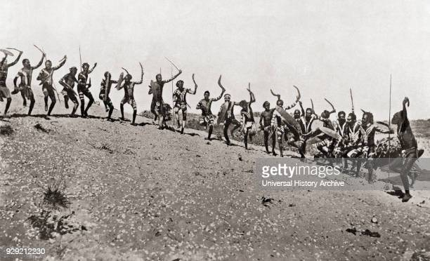 A war dance by natives of Kimberley Region western Australia The warriors mostly carried shields and boomerangs though one or two had spears Such a...