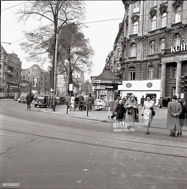 War destructions in Berlin Charlottenburg Street view of the Kurfürstendamm at the corner to the Uhlandstraße in the background the tower of the...