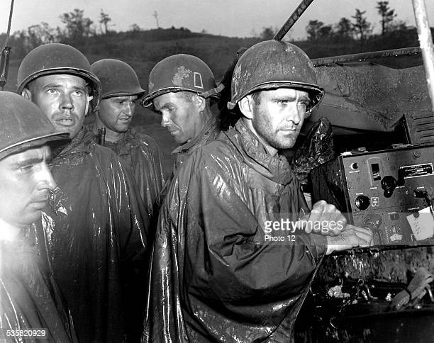 War in the Pacific Okinawa 'Death Valley' US soldiers of the 77th infantry division learning the German surrender of May 8 on radio May 10 Japan...