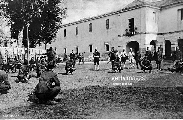 War Italy Ottoman empire italian annexation of Libya Turkish prisoners of war doing sports exercizes in a barrack yard in Caserta Autumn 1911...