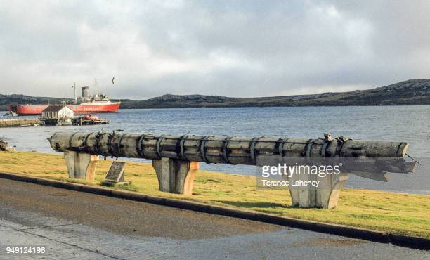 War memorial from 1914 Falklands conflict with Europic Ferry one of the civilian ships requisitioned for the British task force pictured in the...