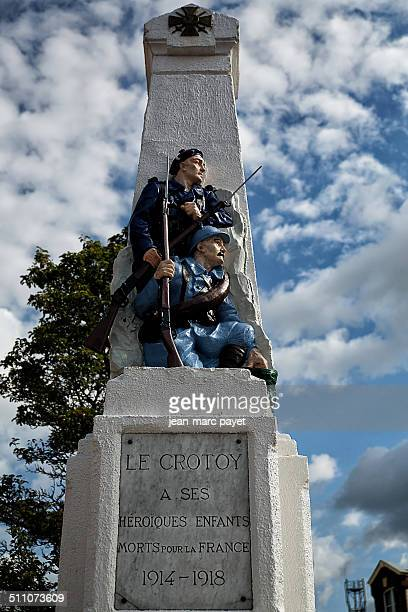War memorial in the city of Le Crotoy, Bay of Somme, Picardy, France. Obelisk with a bronze relief of two soldiers, world war I 1914-1918