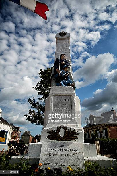 War memorial in the city of Le Crotoy in France Picardy in the Bay of Somme Hairy standing holding his rifle in his hand Obelisk with a bronze relief...