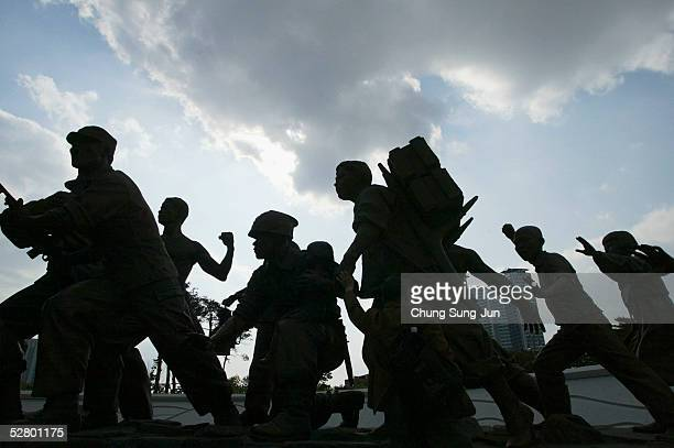 A war memorial statue is silhouetted against the sky on May 12 2005 in Seoul South Korea The memorial commemorates the tragedy of the Korean war and...