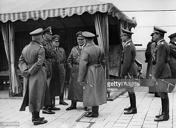 War minister Werner von Blomberg state secretary Erhard Milch and minister president Hermann Göring on the roof of the Ministry of Aviation September...