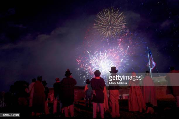 War of 1812 reenactors watch a fireworks display following a ceremony to commemorate the bicentennial of the writing of The StarSpangled Banner at...