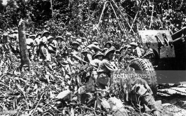 War of Indochina : Dien Bien Phu battle, 1954 : Viet-Minh soldiers crossing moutains and forests with cannons approaching Dien Bien Phu