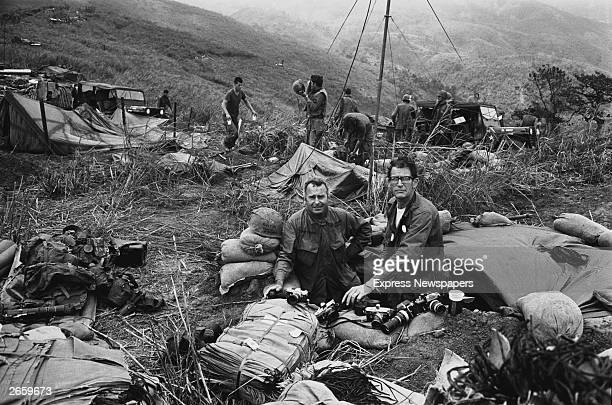 War photographers Terry Fincher of the Daily Express left and Larry Burrows from Life Magazine right on Hill Timothy Vietnam