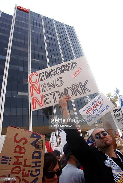 War protesters outside of the Cable News Network building criticize CNN's coverage of the USled war against Iraq during a demonstration March 22 2003...