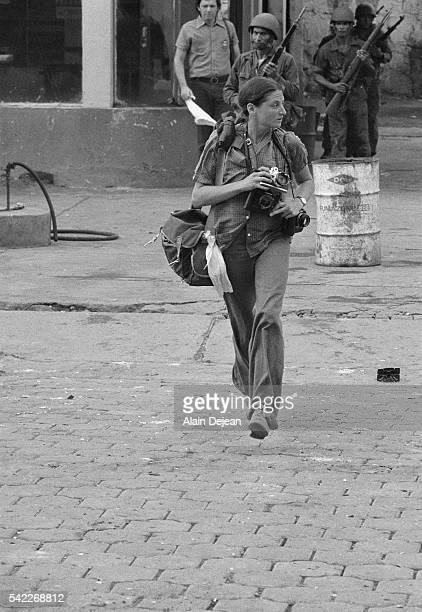 War reporter Susan Meiselas photographs in the streets of Leon during the civil war The war fought between the Sandinista government and USbacked...