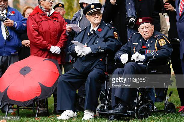 War vet Warren Riddell 88 and William Stanfield 92 watch at sunrise ceremony at The Cross of Sacrifice Prospect Cemetery