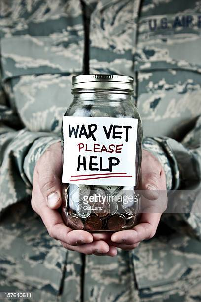 US War Veteran Holding Donation Jar