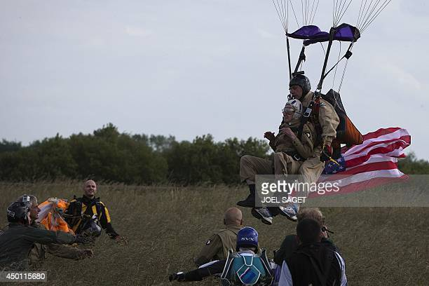 US war veteran Jim 'Pee Wee' Martin lands with a parachute on June 5 2014 in Carentan Normandy where he landed 70 years ago when he was a paratrooper...