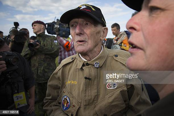 US war veteran Jim 'Pee Wee' Martin looks on after landing with a parachute on June 5 2014 over Carentan where he landed 70 years ago when he was a...