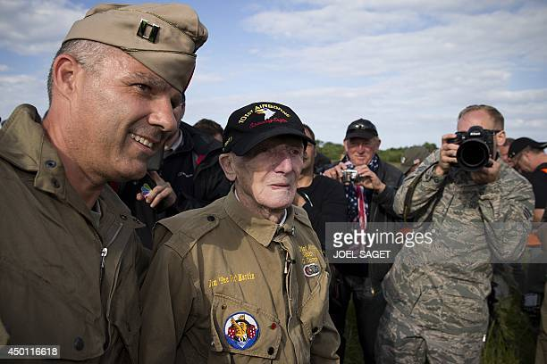 US war veteran Jim 'Pee Wee' Martin reacts after landing with a parachute on June 5 2014 in Carentan where he landed 70 years ago when he was a...