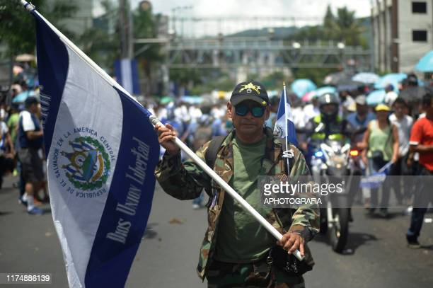 War veteran of El Salvador parades with a Salvadoran flag during the celebrations of El Salvador's 198th Independence Day on September 15, 2019 in...