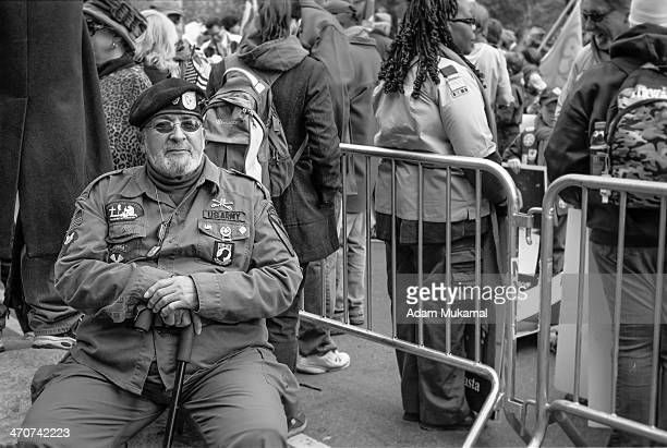 CONTENT] A war veteran showing his decorations and honors during Veteran's Day 2013 Leica IIIg 50mm Elmar
