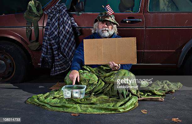 war veteran with blank sign - homeless veterans stock photos and pictures