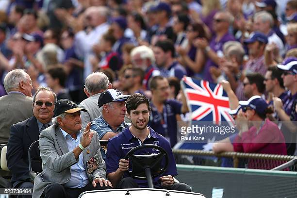 War veterans drive a lap of honour during an ANZAC remembrance ceremony during the round five AFL match between the Fremantle Dockers and the Carlton...