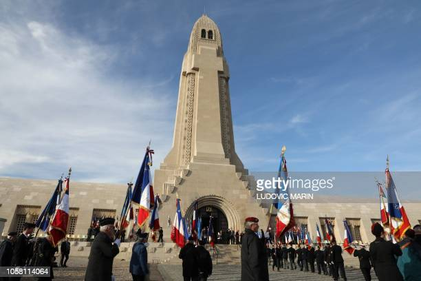 War veterans enter the Ossuary of Douaumont near Verdun northeastern France on November 6 2018 during ceremonies marking the centenary of the First...