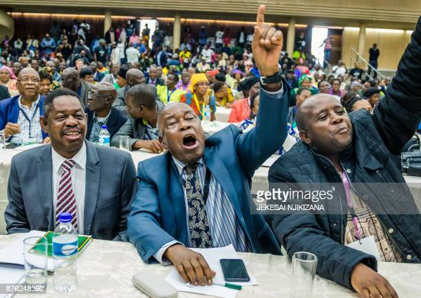 TOPSHOT War Veterans leader Christopher Mutsvangwa celebrates the dismissal of the president of the ruling ZANUPF party on November 19 2017 in Harare...