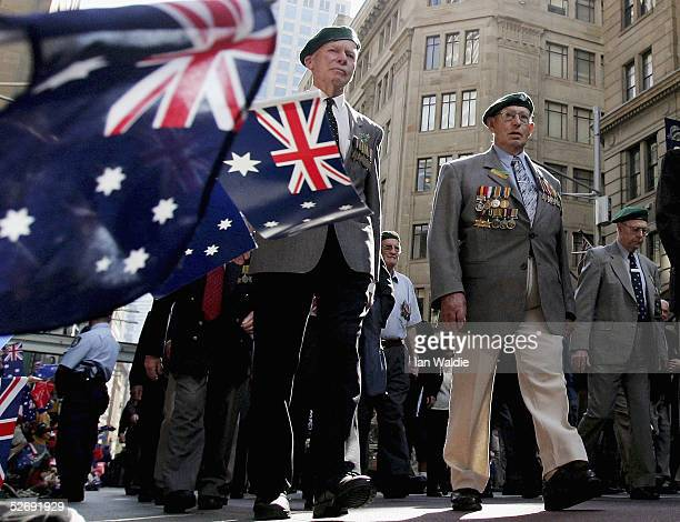 War veterans march as the crowd wave flags during the Anzac Day parade April 25 2005 in Sydney Australia Australians and New Zealanders today...
