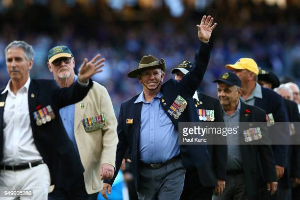 War veterans march before the round five AFL match between the Fremantle Dockers and the Western Bulldogs at Optus Stadium on April 21 2018 in Perth...