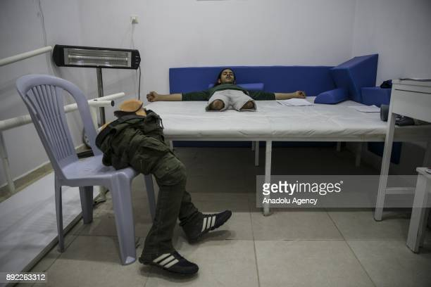 A war wearing Syrian who losts his lower extremities due to the ongoing civilwar waits at a medical center in Turkey's Syrian border city Hatay's...