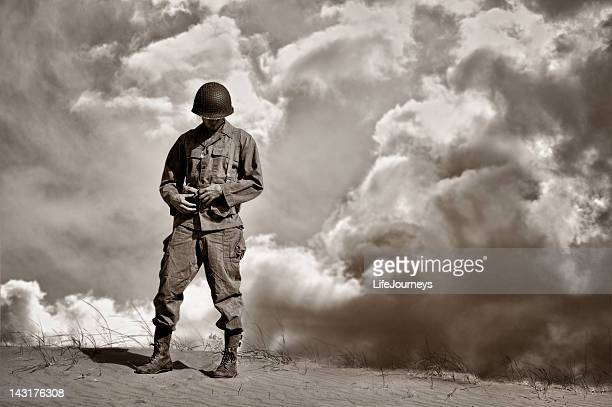war weary wwii soldier during a retrospective moment - remembrance day stock pictures, royalty-free photos & images