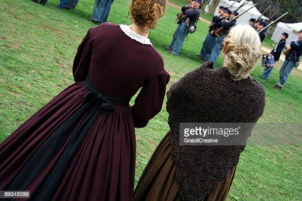 war women: ladies in 1860 costume watch union soldiers - civil war stock pictures, royalty-free photos & images