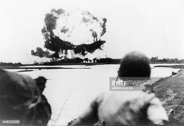 War zone North Vietnam Explosion of a napalm bomb 20 kilometers east of Hanoi in an area where troops of the Viet Minh still remain and which is...