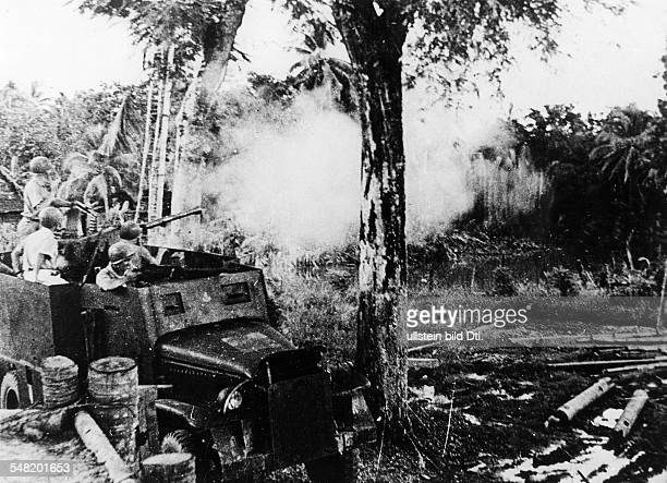 War zone North Vietnam French soldiers in a firefight with Viet Minh rebels from an armored truck July 1950