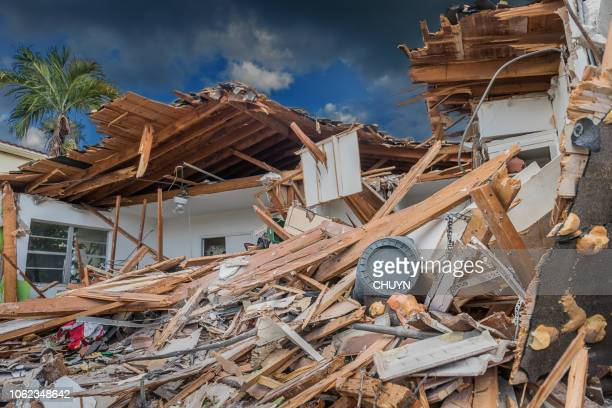 war zone - house collapsing stock pictures, royalty-free photos & images