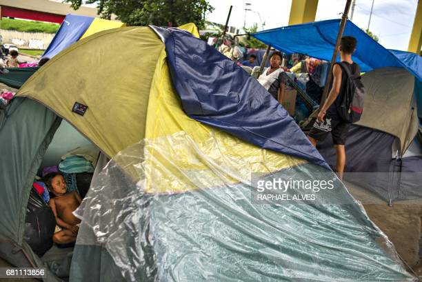 A Warao indigenous toddler is seen asleep inside a tent in an encampment where around 400 Warao from Venezuela are living in Manaus Amazonas Brazil...