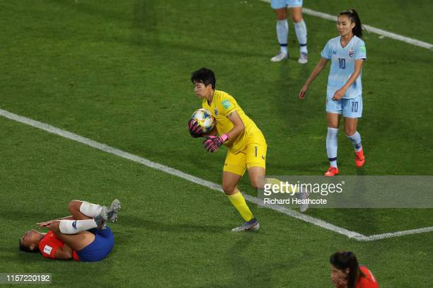 Waraporn Boonsing of Thailand fouls Maria Urrutia of Chile which leads to Chile being awarded a penalty following a VAR review during the 2019 FIFA...