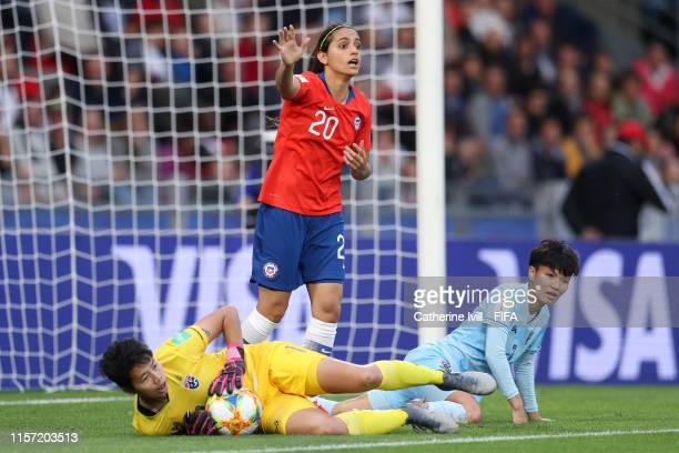 Waraporn Boonsing of Thailand saves from Daniela Zamora of Chile during the 2019 FIFA Women's World Cup France group F match between Thailand and...