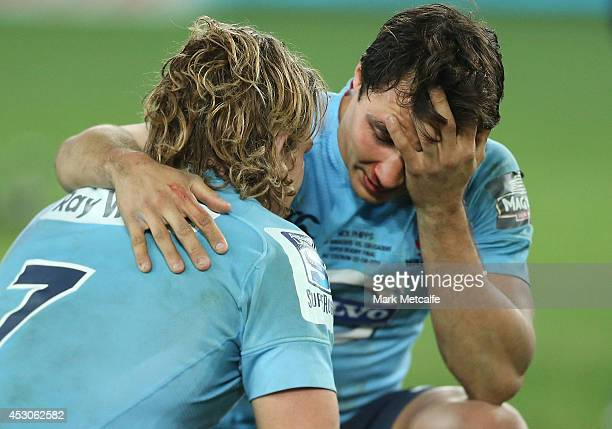 Waratahs captain Michael Hooper and team mate Nick Phipps react after victory in the Super Rugby Grand Final match between the Waratahs and the...