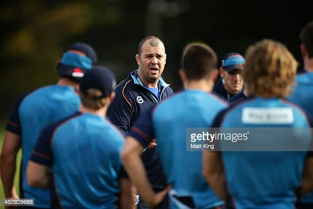 Waratahs coach Michael Cheika speaks to players during a Waratahs Super Rugby training session at Moore Park on July 28 2014 in Sydney Australia
