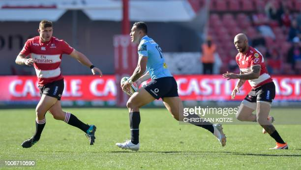 Waratahs' Israel Folau runs to evade Lions' Malcolm Marx during the Super Rugby semifinal match between South Africa's Lions and Australia's Waratahs...