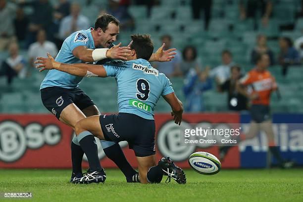 Waratahs Nick Phipps celebrates his try with teammate Matt Carraro during the match against the Blues at Allianz Stadium Sydney Australia Saturday...